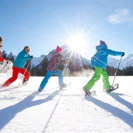 Raquetes de neu en família
